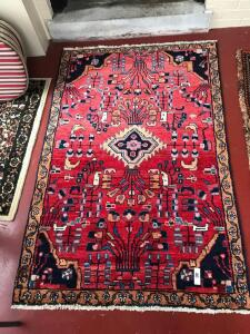 Woven rug with floral design