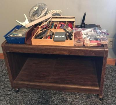 TV stand on casters; stamps; hole punch; pencils