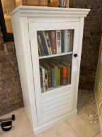 White cabinet with glass front