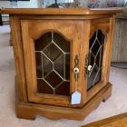 Oak side table with beveled leaded glass doors