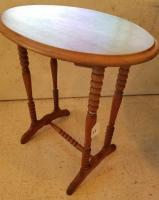 Wooden oval end table with spool legs