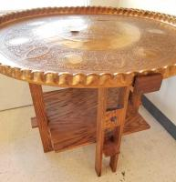 Ornate sunken copper round table with wooden base