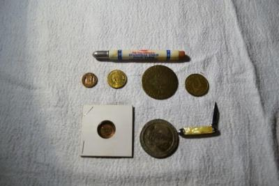 Evansville Coach Lines  Token,  1977 Warrick county bank Boonville In. parking token,Small pocketknife with USA label, mason pin  and other misc.