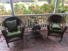 2 wicker arm chairs; side table
