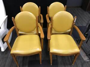 4 yellow padded chairs