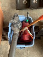 Gas jug, electric leaf blower, saw, small snow shovel, container no top