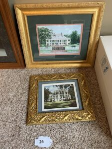 Two gold framed pictures of Plantations