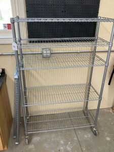 Rolling metal cart with plastic storage bins