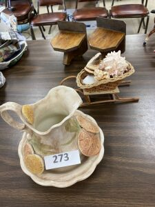 Pair of small shelves, pitcher, wicker sleigh with shells