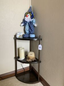 Corner shelf with clown, candle,