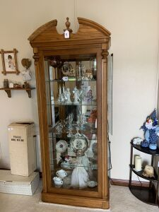 Lighted curio cabinet with mirrored back & glass shelves