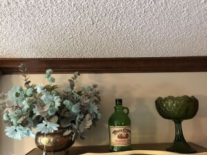 Pedestal green vase; Wolfe & Sons bottle; brass planter