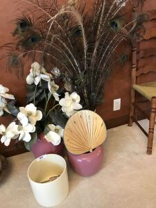 Large planters; peacock feathers; small wicker fan