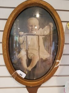 Oval Framed Baby Photograph