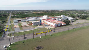 Tract 1: 11.36+/- acres improved w/85,900+/- sf warehouses, shop, office, & grain storage