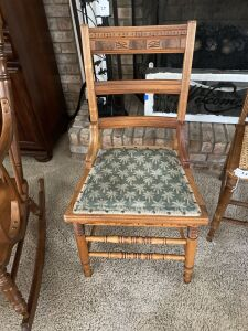 Antique side chair with carved back and upholstered seat