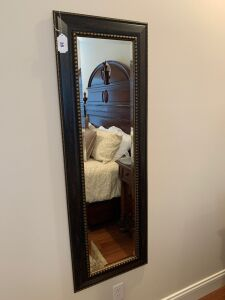 Wall mirror with beveled glass