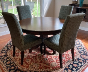 Round pedestal dining table and 4 upholstered chairs