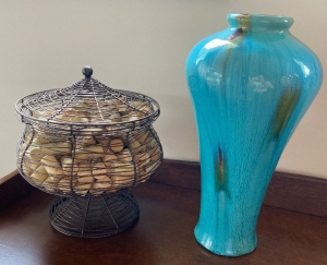 Vase, wire basket with wine corks