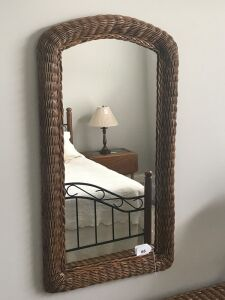 Wicker wall mirror w/ rounded top