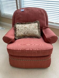 Upholstered swivel rocker & pillow