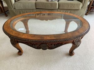 Oval glass & wood coffee table