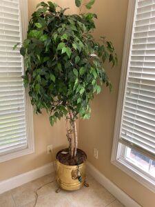 Lighted artificial tree in brass planter