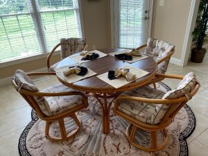 "48"" Rattan table with Formica top and 4 swivel chairs"