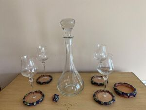 Liquor bottle with stopper, 4 wine glasses and coasters, winds bottle coaster and stopper