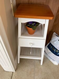Plant stand with drawer, bag of yarn