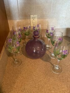 Painted wine glasses, purple glass bottle