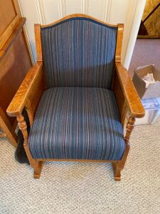 Antique wooden rocker with upholstered seat