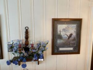 Shelf and contents, wreath, small wind chime