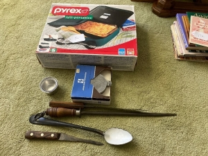 Pyrex dish and carrier, antique hamburger press, knives and spoon