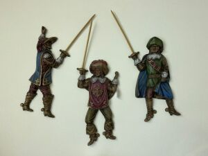 3 wall hangings of men with swords