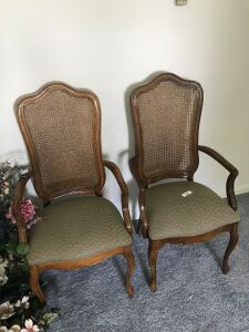 2 wood framed upholstered dining chairs w/ Ratan backs