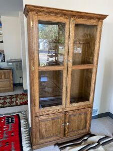 Oak gun cabinet with porcelain knobs