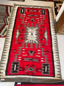 Native American rug with red, grey, white and black color