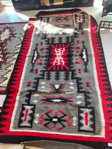 Native American rug with red, grey, black and white color