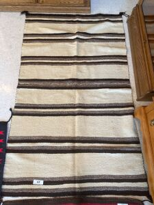 Native American rug with brown and cream colors
