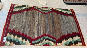 Native American rug with brown, red, cream and green colors