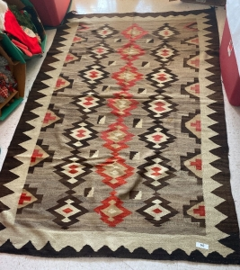 Native American rug with brown, tan and orange colors