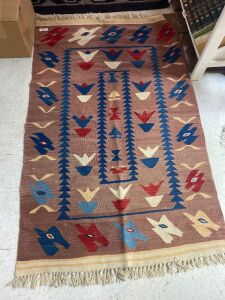 Native American rug with red, blue, cream and rose colors