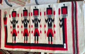 Native American rug with red, black and cream colors