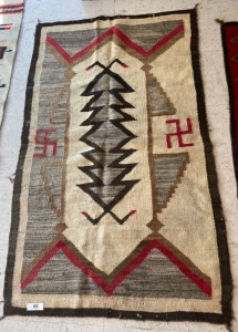 Native American rug with brown, red, cream and tan colors