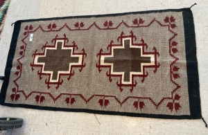Native American rug with red, brown and cream color