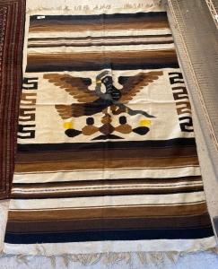 Native American rug with brown, cream and yellow