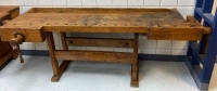 The Christiansen Co  Antique Woodworking table with 2 vises one is missing arm