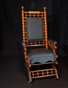 Antique rocker with leather inserts and brass beading