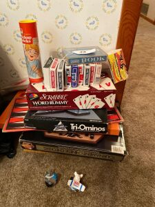 Lot of board games, playing cards, kite